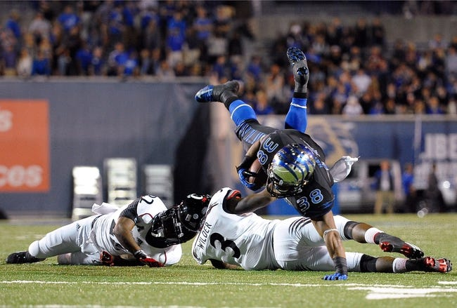 Oct 30, 2013; Memphis, TN, USA; Memphis Tigers running back Brandon Hayes (38) handles the ball against Cincinnati Bearcats during the second half at Liberty Bowl Memorial. Cincinnati Bearcats defeated the Memphis Tigers 34 to 21 Mandatory Credit: Justin Ford-USA TODAY Sports