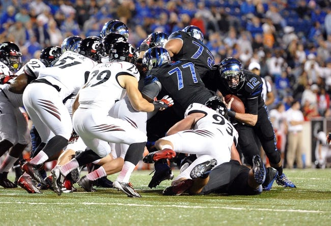Oct 30, 2013; Memphis, TN, USA; Memphis Tigers quarterback Paxton Lynch (12) carries the ball against Cincinnati Bearcats during the second half at Liberty Bowl Memorial. Cincinnati Bearcats defeated the Memphis Tigers 34 to 21 Mandatory Credit: Justin Ford-USA TODAY Sports