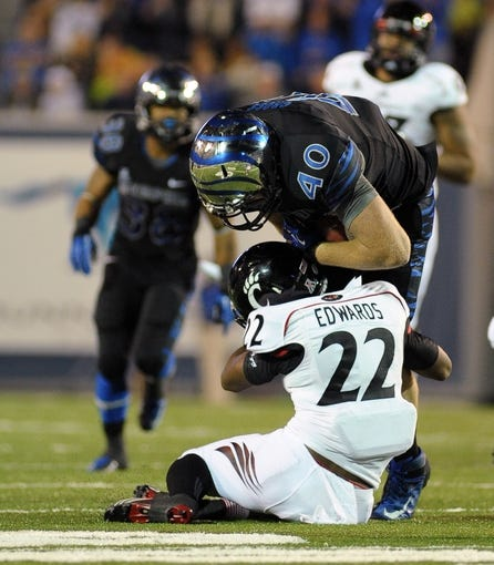 Oct 30, 2013; Memphis, TN, USA; Memphis Tigers tight end Alan Cross (40) is tackled by Cincinnati Bearcats safety Zach Edwards (22) during the second half at Liberty Bowl Memorial. Cincinnati Bearcats defeated the Memphis Tigers 34 to 21 Mandatory Credit: Justin Ford-USA TODAY Sports
