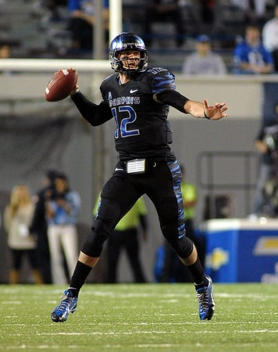 Oct 30, 2013; Memphis, TN, USA; Memphis Tigers quarterback Paxton Lynch (12) passes the ball against Cincinnati Bearcats during the second half at Liberty Bowl Memorial. Cincinnati Bearcats defeated the Memphis Tigers 34 to 21 Mandatory Credit: Justin Ford-USA TODAY Sports