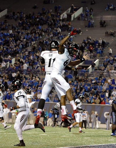 Oct 30, 2013; Memphis, TN, USA; Cincinnati Bearcats wide receiver Anthony McClung (6) and Cincinnati Bearcats quarterback Brendon Kay (11) celebrate after scoring a touchdown against Memphis Tigers during the second half at Liberty Bowl Memorial. Cincinnati Bearcats defeated the Memphis Tigers 34 to 21 Mandatory Credit: Justin Ford-USA TODAY Sports