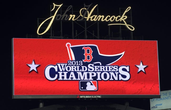 Oct 30, 2013; Boston, MA, USA; The scoreboard displays a message for the World Series champions the Boston Red Sox after game six of the MLB baseball World Series against the St. Louis Cardinals at Fenway Park. The Red Sox won 6-1 to win the series four games to two. Mandatory Credit: Bob DeChiara-USA TODAY Sports