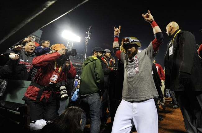 Oct 30, 2013; Boston, MA, USA; Boston Red Sox left fielder Jonny Gomes heads to the clubhouse after game six of the MLB baseball World Series against the St. Louis Cardinals at Fenway Park. The Red Sox won 6-1 to win the series four games to two. Mandatory Credit: Robert Deutsch-USA TODAY Sports