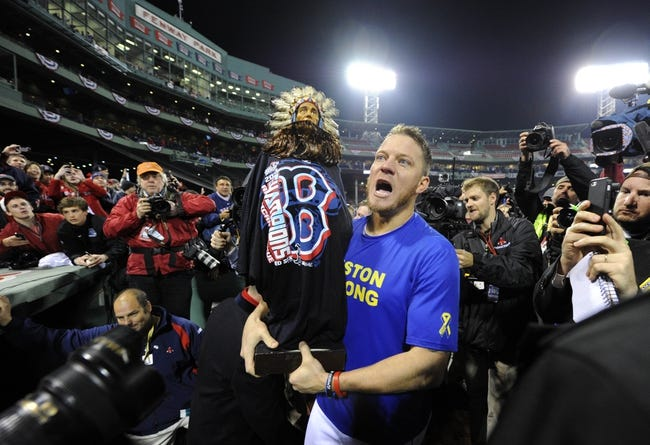 Oct 30, 2013; Boston, MA, USA; Boston Red Sox starting pitcher Jake Peavy celebrates on the field after game six of the MLB baseball World Series against the St. Louis Cardinals at Fenway Park. The Red Sox won 6-1 to win the series four games to two. Mandatory Credit: Robert Deutsch-USA TODAY Sports