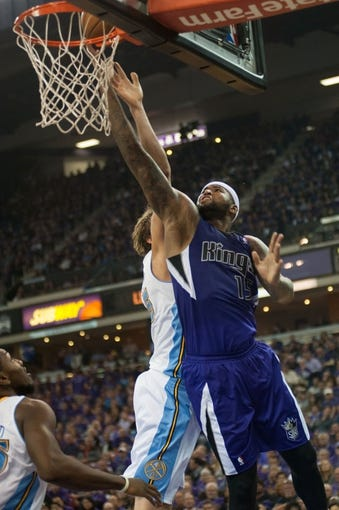 Oct 30, 2013; Sacramento, CA, USA; Sacramento Kings center DeMarcus Cousins (15) takes the ball to the basket against Denver Nuggets center Timofey Mozgov (25) during the fourth quarter at Sleep Train Arena. The Sacramento Kings defeated the Denver Nuggets 90-88. Mandatory Credit: Ed Szczepanski-USA TODAY Sports