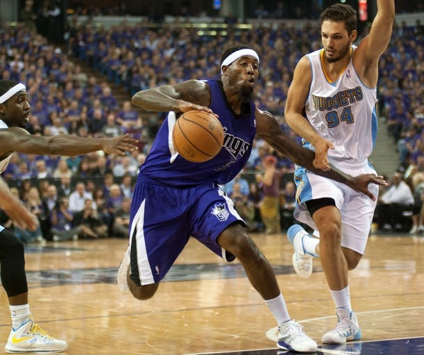 Oct 30, 2013; Sacramento, CA, USA; Sacramento Kings small forward John Salmons (5) drives to the basket against Denver Nuggets shooting guard Evan Fournier (94) during the fourth quarter at Sleep Train Arena. The Sacramento Kings defeated the Denver Nuggets 90-88. Mandatory Credit: Ed Szczepanski-USA TODAY Sports