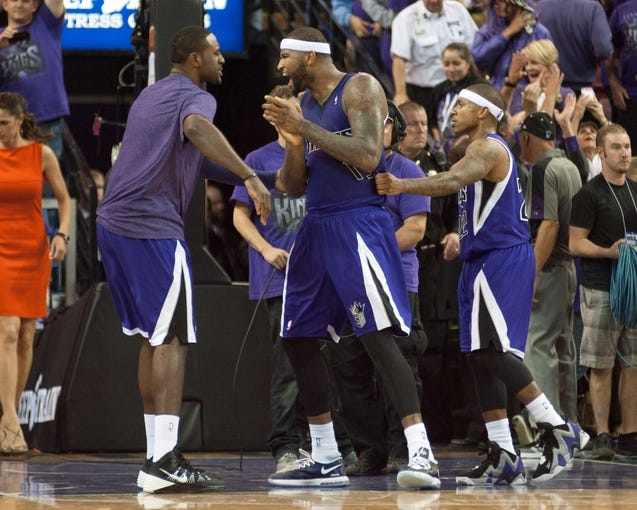 Oct 30, 2013; Sacramento, CA, USA; Sacramento Kings center DeMarcus Cousins (15) celebrates after defeating the Denver Nuggets 90-88 at Sleep Train Arena. Mandatory Credit: Ed Szczepanski-USA TODAY Sports