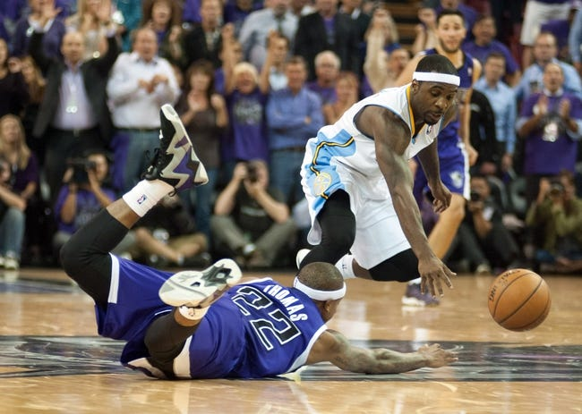 Oct 30, 2013; Sacramento, CA, USA; Sacramento Kings point guard Isaiah Thomas (22) and Denver Nuggets point guard Ty Lawson (3) fight for possession of the ball during the fourth quarter at Sleep Train Arena. The Sacramento Kings defeated the Denver Nuggets 90-88. Mandatory Credit: Ed Szczepanski-USA TODAY Sports