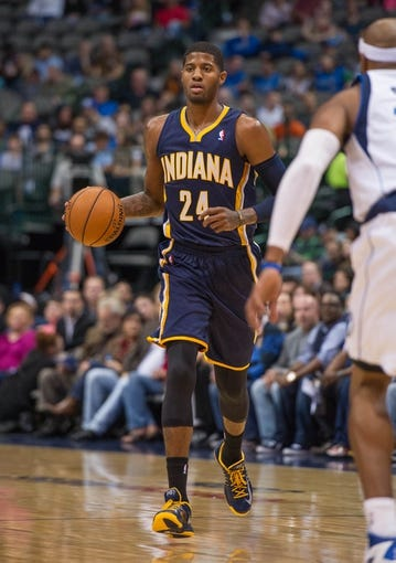 Oct 25, 2013; Dallas, TX, USA; Indiana Pacers shooting guard Paul George (24) brings the ball up the court during the game against the Dallas Mavericks at the American Airlines Center. The Pacers defeated the Mavericks 98-77. Mandatory Credit: Jerome Miron-USA TODAY Sports
