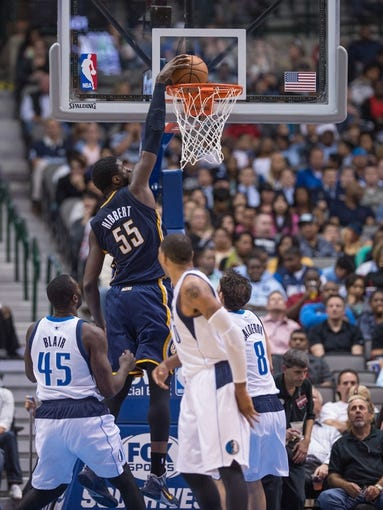 Oct 25, 2013; Dallas, TX, USA; Indiana Pacers center Roy Hibbert (55) dunks the ball over Dallas Mavericks center DeJuan Blair (45) and point guard Jose Calderon (8) during the game at the American Airlines Center. The Pacers defeated the Mavericks 98-77. Mandatory Credit: Jerome Miron-USA TODAY Sports