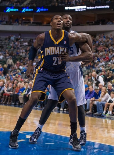 Oct 25, 2013; Dallas, TX, USA; Indiana Pacers center Ian Mahinmi (28) and Dallas Mavericks center DeJuan Blair (45) fight for position during the game at the American Airlines Center. The Pacers defeated the Mavericks 98-77. Mandatory Credit: Jerome Miron-USA TODAY Sports