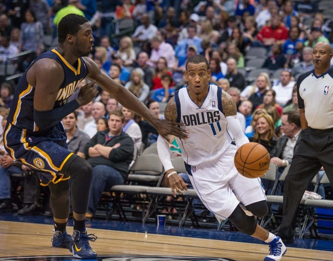 Oct 25, 2013; Dallas, TX, USA; Dallas Mavericks point guard Monta Ellis (11) drives to the basket past Indiana Pacers center Roy Hibbert (55) during the game at the American Airlines Center. The Pacers defeated the Mavericks 98-77. Mandatory Credit: Jerome Miron-USA TODAY Sports