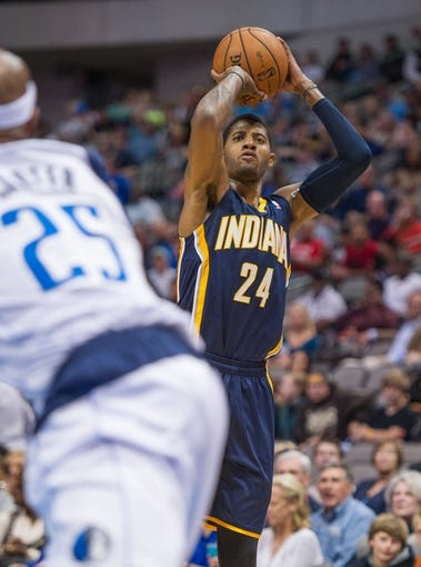 Oct 25, 2013; Dallas, TX, USA; Indiana Pacers shooting guard Paul George (24) shoots the ball against the Dallas Mavericks during the game at the American Airlines Center. The Pacers defeated the Mavericks 98-77. Mandatory Credit: Jerome Miron-USA TODAY Sports