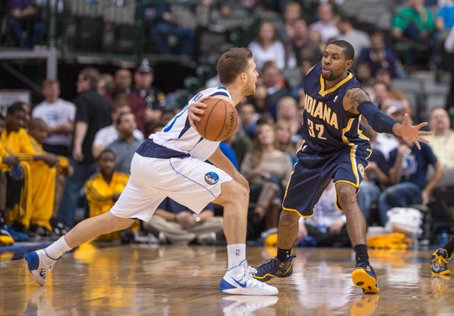 Oct 25, 2013; Dallas, TX, USA; Indiana Pacers point guard C.J. Watson (32) defends against Dallas Mavericks point guard Gal Mekel (33) during the game at the American Airlines Center. The Pacers defeated the Mavericks 98-77. Mandatory Credit: Jerome Miron-USA TODAY Sports