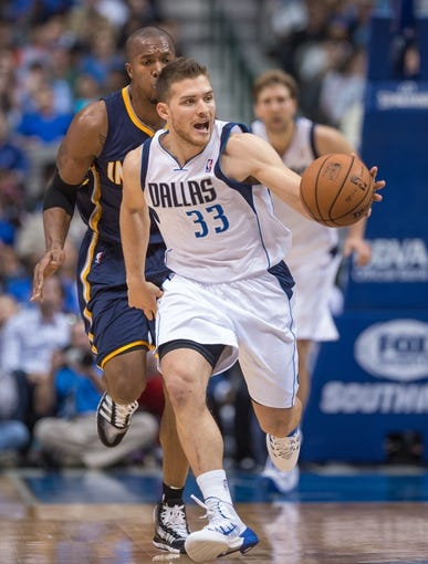 Oct 25, 2013; Dallas, TX, USA; Dallas Mavericks point guard Gal Mekel (33) steals the ball during the game against the Indiana Pacers at the American Airlines Center. The Pacers defeated the Mavericks 98-77. Mandatory Credit: Jerome Miron-USA TODAY Sports