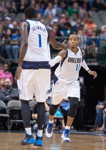 Oct 25, 2013; Dallas, TX, USA; Dallas Mavericks center Samuel Dalembert (1) congratulates point guard Monta Ellis (11) during the game against the Indiana Pacers at the American Airlines Center. The Pacers defeated the Mavericks 98-77. Mandatory Credit: Jerome Miron-USA TODAY Sports