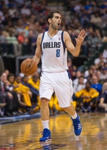 Oct 25, 2013; Dallas, TX, USA; Dallas Mavericks point guard Jose Calderon (8) brings the ball up court during the game against the Indiana Pacers at the American Airlines Center. The Pacers defeated the Mavericks 98-77. Mandatory Credit: Jerome Miron-USA TODAY Sports