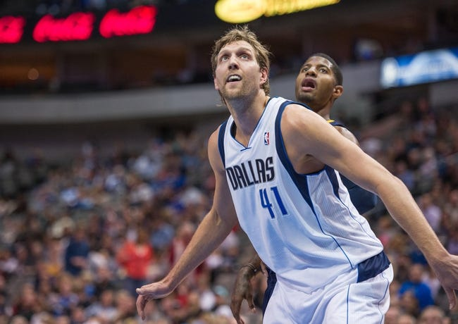 Oct 25, 2013; Dallas, TX, USA; Dallas Mavericks power forward Dirk Nowitzki (41) boxes out Indiana Pacers shooting guard Paul George (24) during the game at the American Airlines Center. The Pacers defeated the Mavericks 98-77. Mandatory Credit: Jerome Miron-USA TODAY Sports