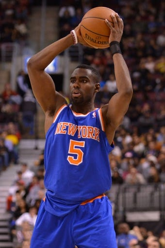 Oct 21, 2013; Toronto, Ontario, CAN; New York Knicks shooting guard Tim Hardaway Jr. (5) looks to pass the ball in the second half of a game against the Toronto Raptors at the Air Canada Centre.Toronto won the game in overtime123-120. Mandatory Credit: Mark Konezny-USA TODAY Sports