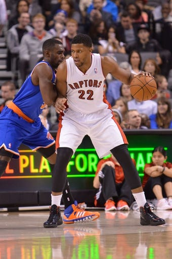 Oct 21, 2013; Toronto, Ontario, CAN; Toronto Raptors small forward Rudy Gay (22) posts up against New York Knicks shooting guard Tim Hardaway Jr. (5) in the first half of a game at the Air Canada Centre.Toronto won the game in overtime123-120. Mandatory Credit: Mark Konezny-USA TODAY Sports
