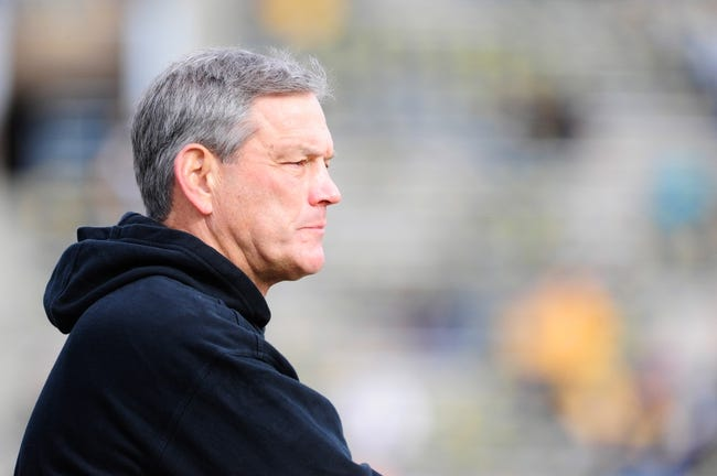 Oct 26, 2013; Iowa City, IA, USA; Iowa Hawkeyes head coach Kirk Ferentz watches his team warm up prior to game against the Nothwestern Wildcats at Kinnick Stadium. Mandatory Credit: Byron Hetzler-USA TODAY Sports