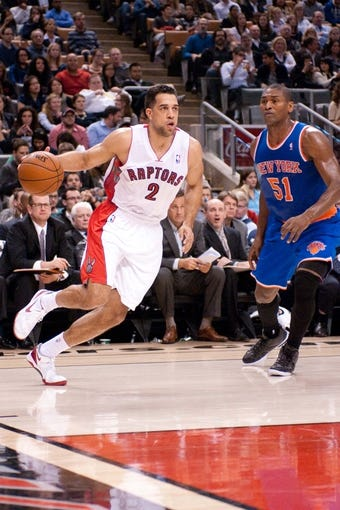 Oct 21, 2013; Toronto, Ontario, CAN; Toronto Raptors small forward Landry Fields (2) gets the ball past New York Knicks small forward Metta World Peace (51) in the first half of a game at the Air Canada Centre.Toronto won the game in overtime123-120. Mandatory Credit: Mark Konezny-USA TODAY Sports