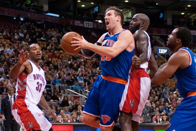 Oct 21, 2013; Toronto, Ontario, CAN; New York Knicks point guard Beno Udrih (18) tries to shoot the ball with Toronto Raptors small forward Chris Wright (33) and small forward Quincy Acy (right) defending in the second half of a game at the Air Canada Centre.Toronto won the game in triple overtime123-120. Mandatory Credit: Mark Konezny-USA TODAY Sports