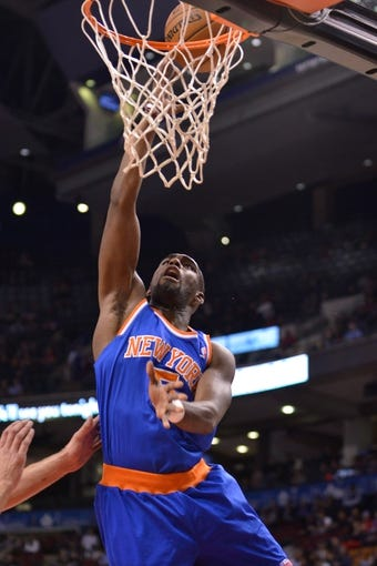 Oct 21, 2013; Toronto, Ontario, CAN; New York Knicks shooting guard Tim Hardaway Jr. (5) makes a lay-up  in the first half of a game against the Toronto Raptors at the Air Canada Centre.Toronto won the game in overtime123-120. Mandatory Credit: Mark Konezny-USA TODAY Sports
