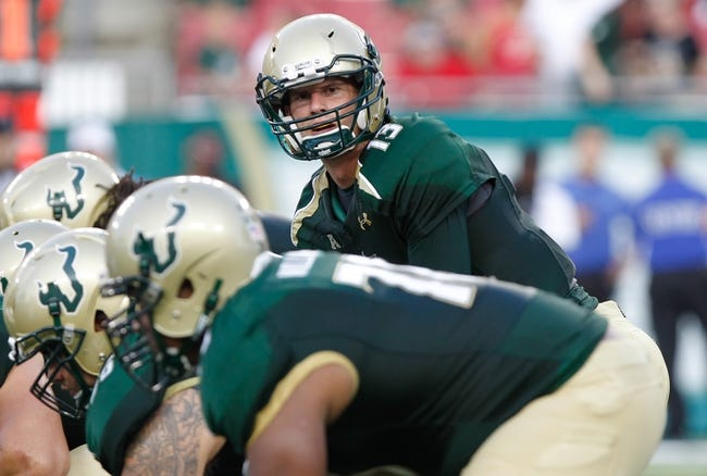 Sep 14, 2013; Tampa, FL, USA; South Florida Bulls quarterback Bobby Eveld (13) against the Florida Atlantic Owls during the first quarter at Raymond James Stadium. Mandatory Credit: Kim Klement-USA TODAY Sports