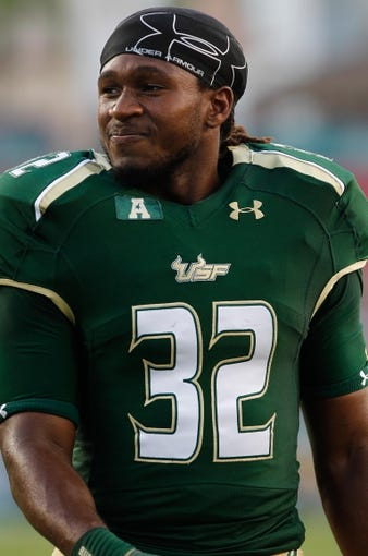 Sep 14, 2013; Tampa, FL, USA; South Florida Bulls running back Willie Davis (32) works out prior to the game against the Florida Atlantic Owls at Raymond James Stadium. Mandatory Credit: Kim Klement-USA TODAY Sports