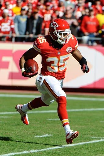 Oct 27, 2013; Kansas City, MO, USA; Kansas City Chiefs defensive back Quintin Demps (35) returns a kick against the Cleveland Browns in the first half at Arrowhead Stadium. The Chiefs won the game 23-17. Mandatory Credit: John Rieger-USA TODAY Sports