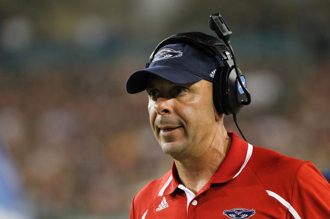 Sep 14, 2013; Tampa, FL, USA; Florida Atlantic Owls head coach Carl Pelini against the South Florida Bulls during the second quarter at Raymond James Stadium. Florida Atlantic Owls defeated the South Florida Bulls 28-10. Mandatory Credit: Kim Klement-USA TODAY Sports