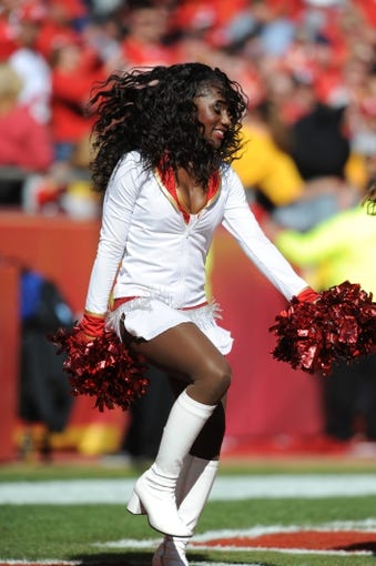 Oct 27, 2013; Kansas City, MO, USA; A Kansas City Chiefs cheerleader performs for the crowd during the second half of the game against the Cleveland Browns at Arrowhead Stadium. The Chiefs won 23-17.  Mandatory Credit: Denny Medley-USA TODAY Sports