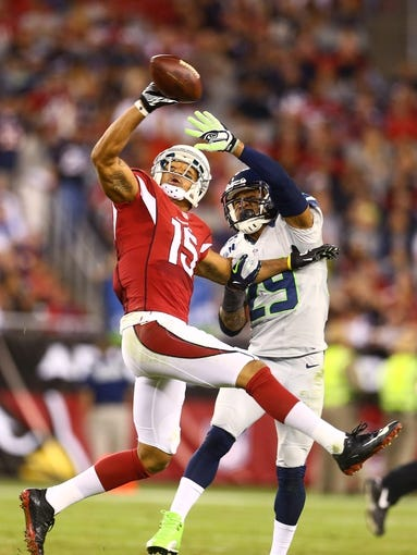 Oct 17, 2013; Phoenix, AZ, USA; Seattle Seahawks safety Earl Thomas (right) breaks up a pass intended for Arizona Cardinals wide receiver Michael Floyd at University of Phoenix Stadium. Mandatory Credit: Mark J. Rebilas-USA TODAY Sports