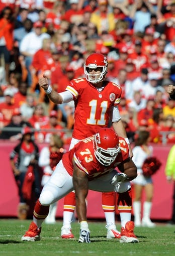 Oct 27, 2013; Kansas City, MO, USA; Kansas City Chiefs quarterback Alex Smith (11) directs a play behind guard Jon Asamoah (73) against the Cleveland Browns in the first half at Arrowhead Stadium. The Chiefs won the game 23-17. Mandatory Credit: John Rieger-USA TODAY Sports