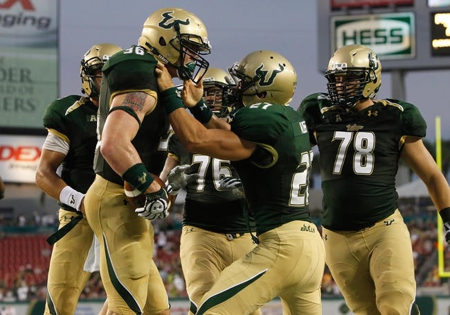 Sep 14, 2013; Tampa, FL, USA; South Florida Bulls fullback Ryan Eppes (36) is congratulated by quarterback Steven Bench (2), kicker Marvin Kloss (27) and teammates after he scored during the first quarter against the Florida Atlantic Owls at Raymond James Stadium. Mandatory Credit: Kim Klement-USA TODAY Sports