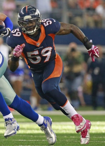 Oct 6, 2013; Arlington, TX, USA; Denver Broncos outside linebacker Danny Trevathan (59) during the game against the Dallas Cowboys at AT&T Stadium. The Denver Broncos beat the Dallas Cowboys 51-48. Mandatory Credit: Tim Heitman-USA TODAY Sports