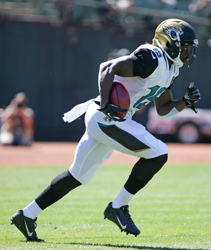 Sep 15, 2013; Oakland, CA, USA; Jacksonville Jaguars wide receiver Stephen Burton (15) on a kickoff return against the Oakland Raiders during the first quarter at O.co Coliseum. Mandatory Credit: Kelley L Cox-USA TODAY Sports