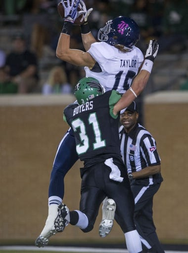 Oct 31, 2013; Denton, TX, USA; Rice Owls wide receiver Jordan Taylor (15) catches a touchdown as North Texas Mean Green defensive back Kenny Buyers (31) defends during the first half at Apogee Stadium. Mandatory Credit: Jerome Miron-USA TODAY Sports