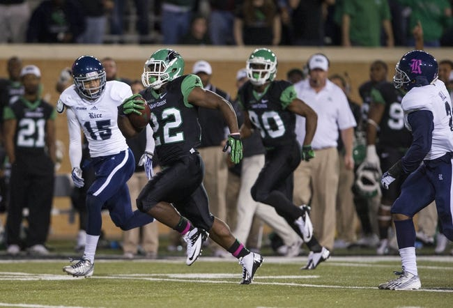 Oct 31, 2013; Denton, TX, USA; North Texas Mean Green running back Antoinne Jimmerson (22) runs for a touchdown against the Rice Owls during the first half at Apogee Stadium. Mandatory Credit: Jerome Miron-USA TODAY Sports