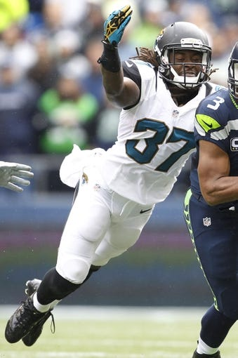 Sep 22, 2013; Seattle, WA, USA; Jacksonville Jaguars strong safety John Cyprien (37) defends the Seattle Seahawks during the second quarter at CenturyLink Field. Mandatory Credit: Joe Nicholson-USA TODAY Sports
