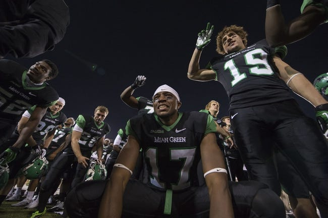 Oct 31, 2013; Denton, TX, USA; North Texas Mean Green wide receiver Lynrick Pleasant (17) and defensive back John Schilleci (19) celebrate the win over the Rice Owls at Apogee Stadium. The Mean Green defeated the Owls 28-16. Mandatory Credit: Jerome Miron-USA TODAY Sports