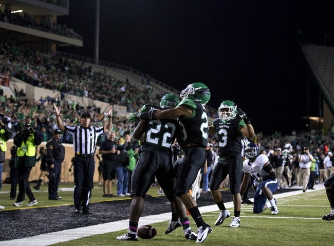 Oct 31, 2013; Denton, TX, USA; Rice Owls cornerback Ryan Pollard (22) and running back Rex Rollins (20) and wide receiver Brelan Chancellor (3) celebrates Pollard's touchdown against the Rice Owls during the second half at Apogee Stadium. The Mean Green defeated the Owls 28-16. Mandatory Credit: Jerome Miron-USA TODAY Sports
