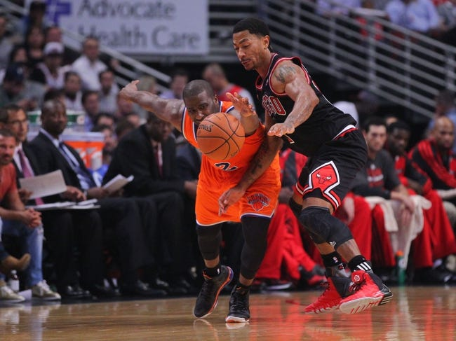 Oct 31, 2013; Chicago, IL, USA; New York Knicks point guard Raymond Felton (2) and Chicago Bulls point guard Derrick Rose (1) fight for the ball during the second half at the United Center. Chicago won 82-81. Mandatory Credit: Dennis Wierzbicki-USA TODAY Sports
