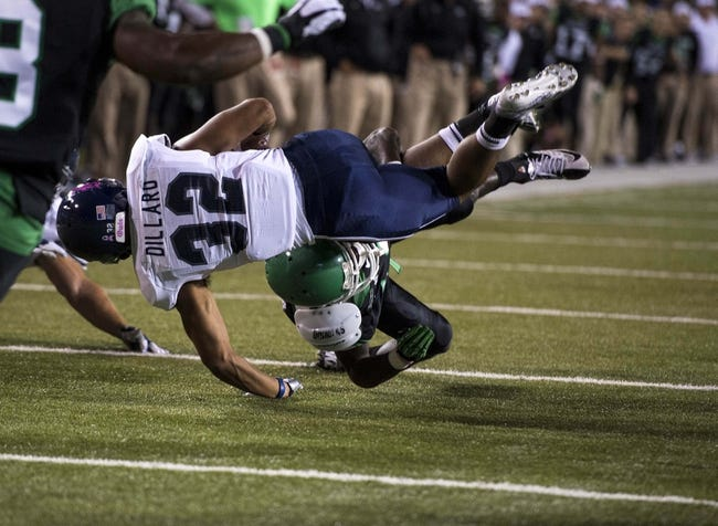 Oct 31, 2013; Denton, TX, USA; Rice Owls running back Darik Dillard (32) is upended by North Texas Mean Green defensive back James Jones (13) during the second half at Apogee Stadium. The Mean Green defeated the Owls 28-16. Mandatory Credit: Jerome Miron-USA TODAY Sports