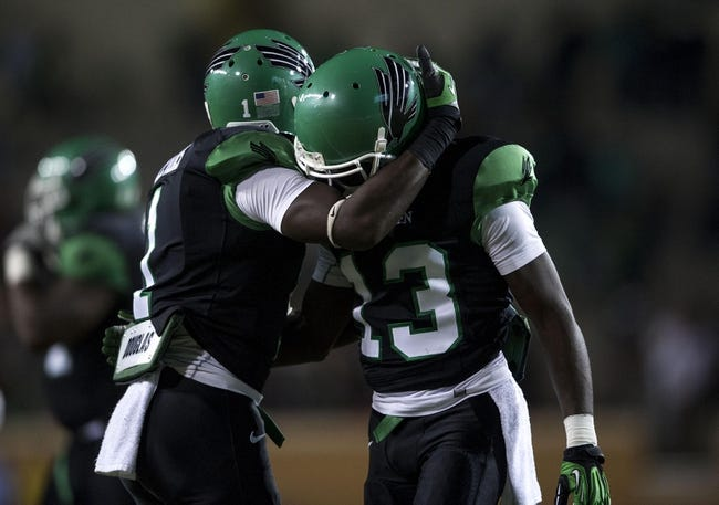 Oct 31, 2013; Denton, TX, USA; North Texas Mean Green defensive back Zed Evans (1) and defensive back James Jones (13) celebrate the win over the Rice Owls at Apogee Stadium. The Mean Green defeated the Owls 28-16. Mandatory Credit: Jerome Miron-USA TODAY Sports
