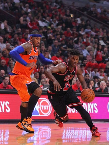Oct 31, 2013; Chicago, IL, USA; Chicago Bulls shooting guard Jimmy Butler (21) drives past New York Knicks small forward Carmelo Anthony (7) during the second half at the United Center. Chicago won 82-81. Mandatory Credit: Dennis Wierzbicki-USA TODAY Sports