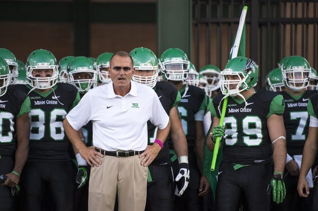 Oct 31, 2013; Denton, TX, USA; North Texas Mean Green head coach Dan McCarney prepares to lead his team on the field to face the Rice Owls at Apogee Stadium. The Mean Green defeated the Owls 28-16. Mandatory Credit: Jerome Miron-USA TODAY Sports