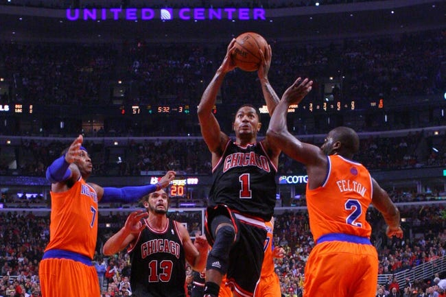 Oct 31, 2013; Chicago, IL, USA; Chicago Bulls point guard Derrick Rose (center) leaps between New York Knicks small forward Carmelo Anthony (left) and point guard Raymond Felton (right) during the second half at the United Center. Chicago won 82-81. Mandatory Credit: Dennis Wierzbicki-USA TODAY Sports