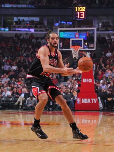 Oct 31, 2013; Chicago, IL, USA; Chicago Bulls center Joakim Noah (13) with the ball during the second half against the New York Knicks at the United Center. Chicago won 82-81. Mandatory Credit: Dennis Wierzbicki-USA TODAY Sports